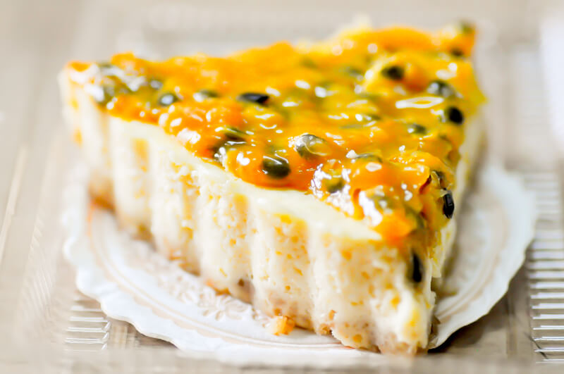 Passionfruit Cheesecake is a baked sweet cream cheesecake with tart and tangy passion fruit topping.