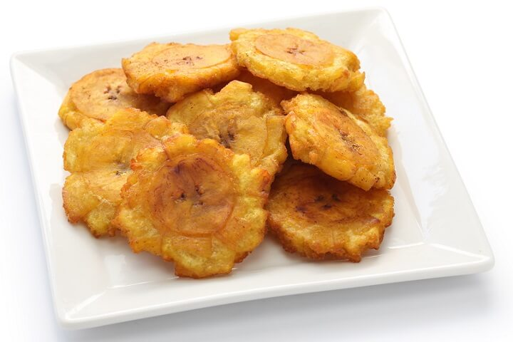 Tostones - Fried Green Plantains - Taste the Islands